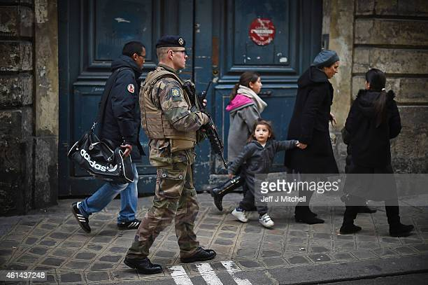 Armed security patrol outside a Jewish School in the Jewish quarter of the Marais district as children make their way home on January 12 2015 in...