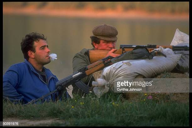 Armed Serbian militiamen keeping watch during battle against separatist Croatian forces re ethnic Serb's opposition to living in independent Croatia