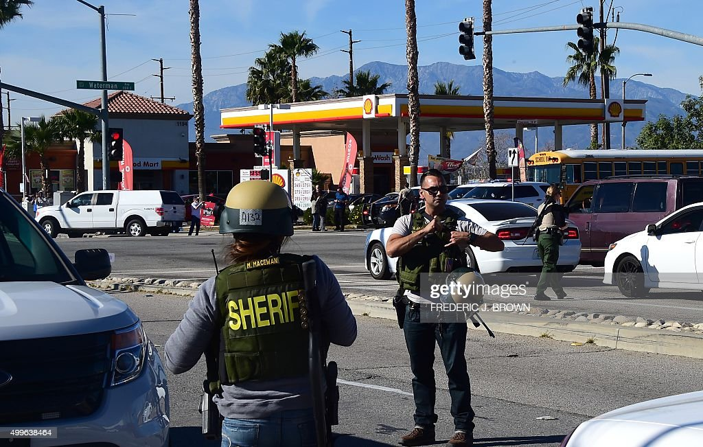 Armed Sheriff's department personel man a roadblock at Waterman Street near the site of a shooting took place on December 2 2015 in San Bernardino...