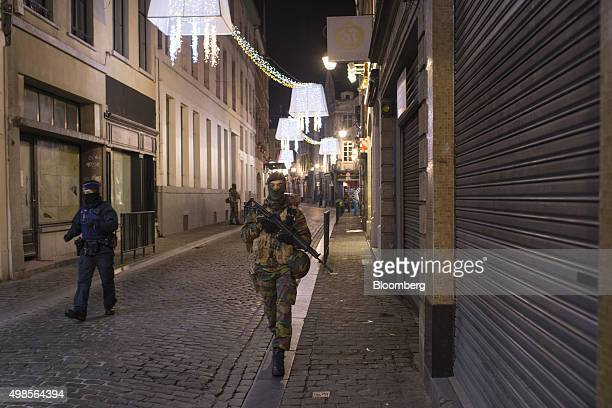 Armed soldiers and police patrol the streets at night near Grand Place square in Brussels Belgium on Monday Nov 23 2015 Authorities in Brussels...