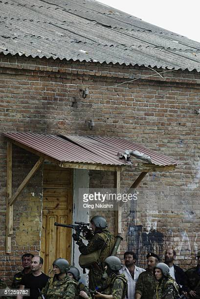 Armed soldiers cover the area as special forces stormed a school seized by Chechen separatists on September 3 2004 in the town of Beslan Russia...