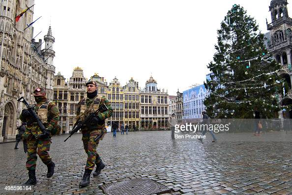 Armed soldiers patrol around the Grand Place on November 24 2015 in Brussels Belgium At a press conference last night the Belgian Prime Minister...