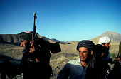 Armed Taliban soldiers ride on a pick-up truck outside Kabul, Afghanistan