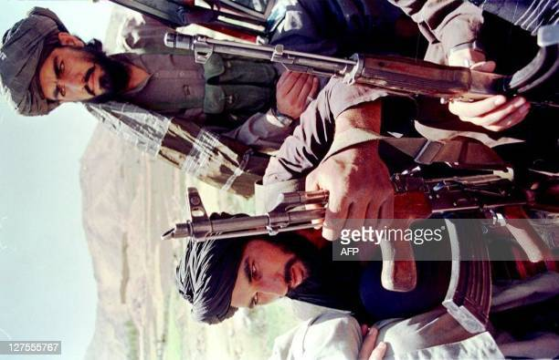 Armed with a variety of Kalashnikov assault rifles and packed into the back of a jeep Afghan Taliban fighters speed towards frontlines close to the...