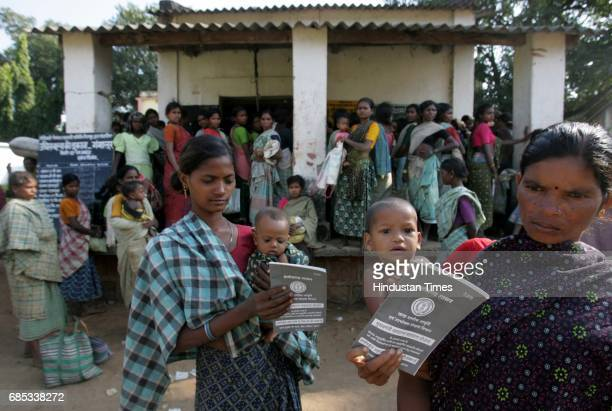 Armed with ration cards issued by the Chhattisgarh state government women from Bijapur districts Ganglur village flock to a local weekly market to...