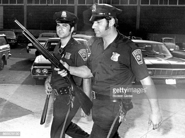 Armed with shotguns Boston Police officers Joseph Patti and Nicholas Saggese return to Station 2 following a narcotics raid on Oct 15 1971