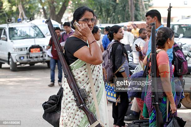 Armed Woman security personnel alongwith polling officials on their way to polling booth from Golghar for the third phase of the ongoing Bihar...