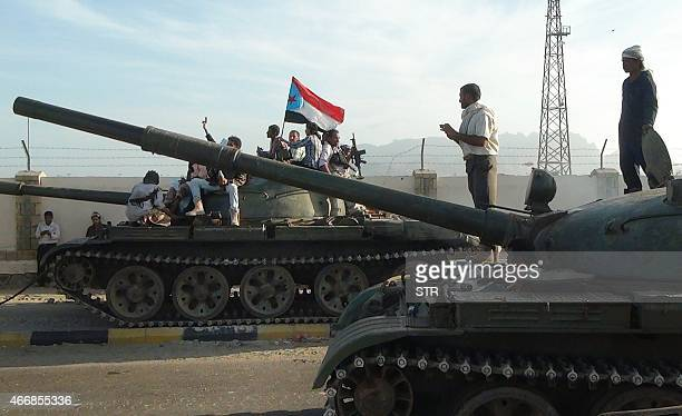 Armed Yemeni militiamen loyal to President Abedrabbo Mansour Hadi also known as the Popular Resistance Committees sit on tanks one flying the...