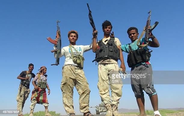 Armed Yemeni tribesmen from the Popular Resistance Committees supporting forces loyal to Yemen's Saudibacked President Abedrabbo Mansour Hadi flash...