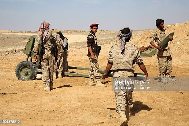 Armed Yemeni tribesmen from the Popular Resistance Committees supporting forces loyal to Yemen's Saudibacked President Abedrabbo Mansour Hadi carry...