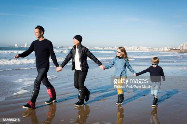 Armel Le Cleac'h winner of the Vendee Globe around the world solo yacht race 20162017 is photographed with his wife and children for Paris Match on...