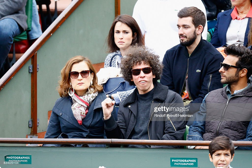 Armelle Lesniak and guest attend the 2016 French Tennis Open - Day Three at Roland Garros on May 24, 2016 in Paris, France.