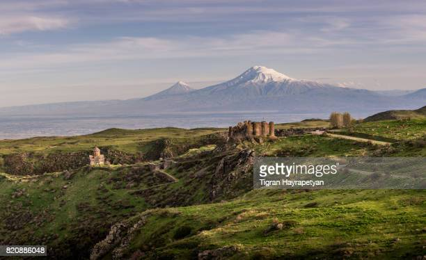 Armenia, Amberd fortress and Vahramashen Church in the background of the mt. Ararat.