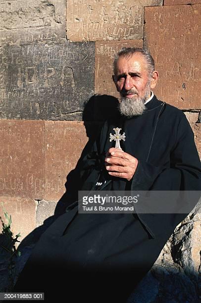 Armenia, Khor Virap Monastery, man holding cross, portrait
