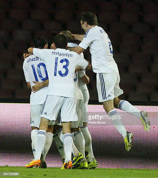 Armenia players celebrates the second team's goal scored by Henrikh Mkhitaryan during the FIFA 2014 World Cup qualifier group B match between Italy...