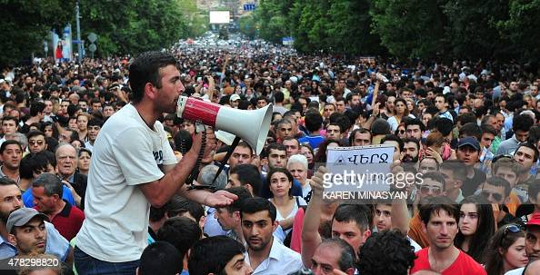 Armenian demonstrators hold a placard reading 'Put an end to embezzlement' during a protest against an increase of electricity prices in Yerevan on...