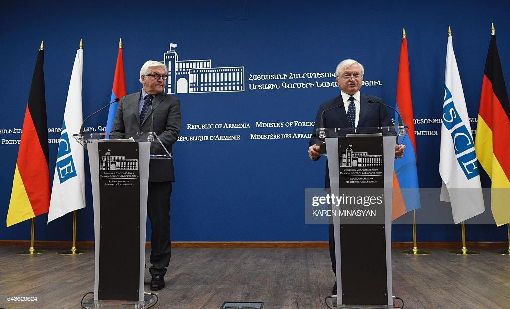 Armenian Foreign Minister Edward Nalbandian (R) delivers a speech next to his German counterpart Frank-Walter Steinmeier (L), who currently chairs the Organisation for Security and Cooperation in Europe (OSCE) monitoring body, during a press conference in Yerevan on June 29, 2016. / AFP / KAREN