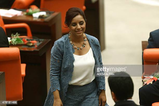 Armenian lawmaker Selina Dogan of the opposition party Republican People's Party prepares to take her oath at the Turkish parliament in Ankara during...