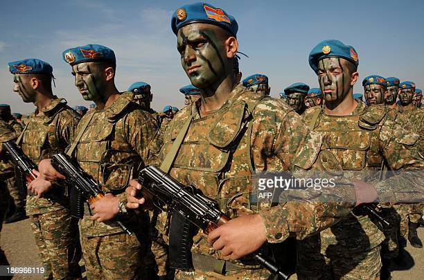 Armenian military scouts attend a performance to mark the annual anniversary of the Armenian Armed Forces reconnaissance troops formation some 25 km...