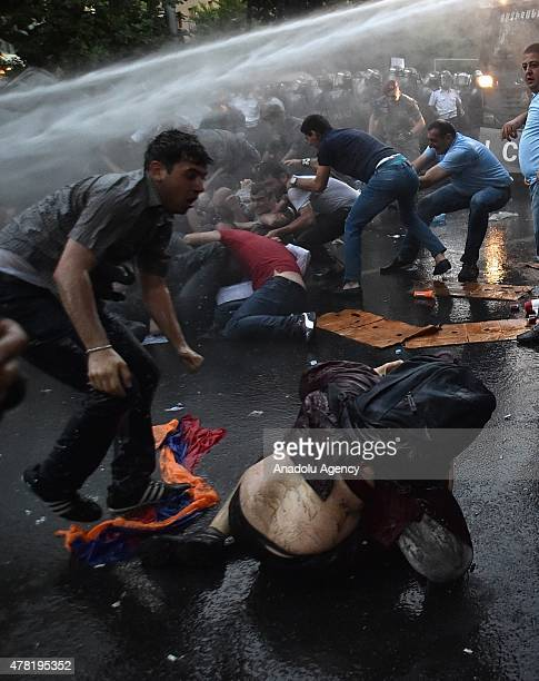 Armenian police intervene protestors with force and water cannons to clear a demonstration in central Yerevan overnight after a standoff with...