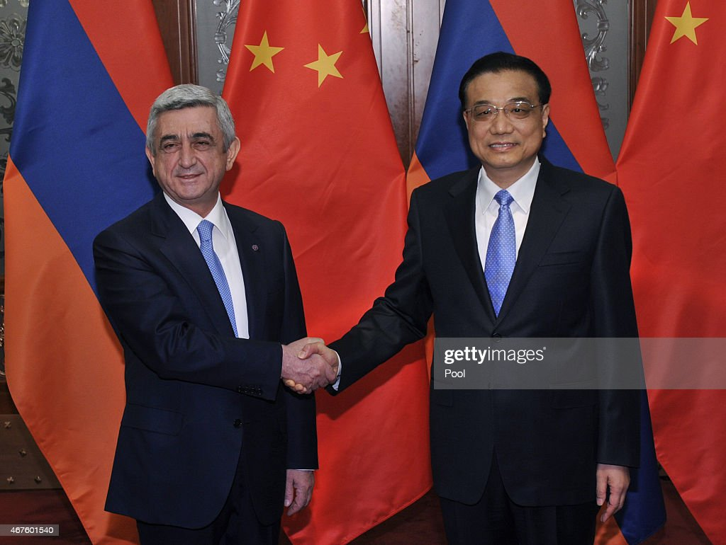 Armenian President <a gi-track='captionPersonalityLinkClicked' href=/galleries/search?phrase=Serzh+Sargsyan&family=editorial&specificpeople=4583219 ng-click='$event.stopPropagation()'>Serzh Sargsyan</a> (L) shakes hands with Chinese Premier <a gi-track='captionPersonalityLinkClicked' href=/galleries/search?phrase=Li+Keqiang&family=editorial&specificpeople=2481781 ng-click='$event.stopPropagation()'>Li Keqiang</a> before a meeting at the Great Hall of the People on March 26, 2015 in Beijing, China.