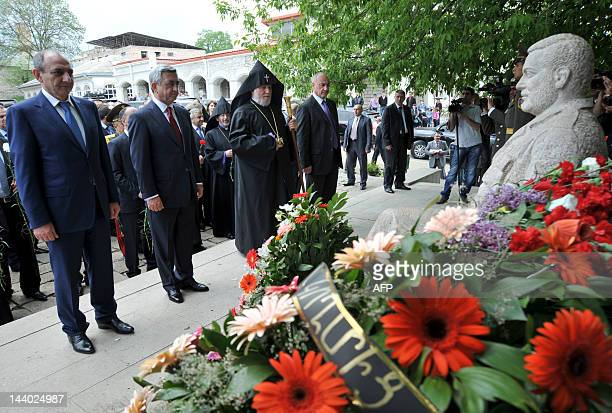 Armenian President Serzh Sarkisian lays a wreath in the village of Shushi on May 8 2012 at a monument for those killed in the NagornoKarabakh...