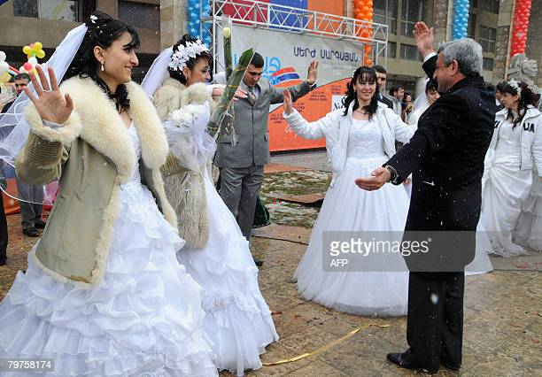 Armenian Prime Minister Serzh Sarkisian dances with newly married couples during his election rally in the town of Artashat outside Yerevan on...