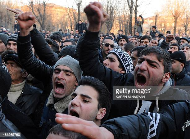 Armenian protesters shout slogans on January 15 2015 in front of the prosecutor's office in Gyumri as they demand Russian soldier Valery Permyakov...