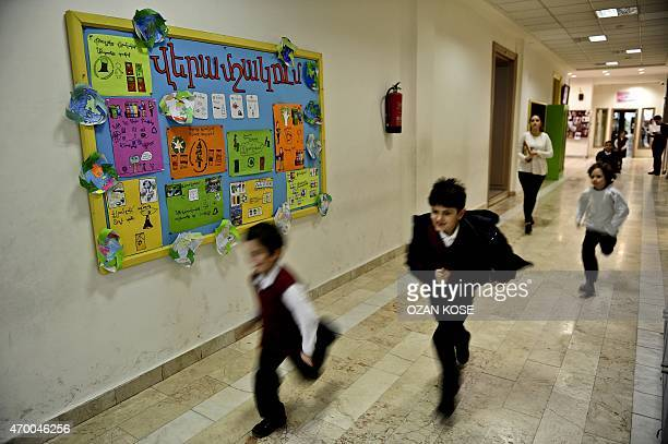 Armenian pupils run to their classroom at the Karagozyan Armenian primary school in Istanbul on March 27 2015 Yasmin Rostomyan one of around 60000...