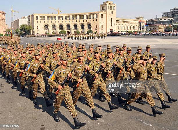 Armenian soldiers march during a military parade marking the 20th anniversary of the nation independence Yerevan on September 21 2011 Armenia flexed...