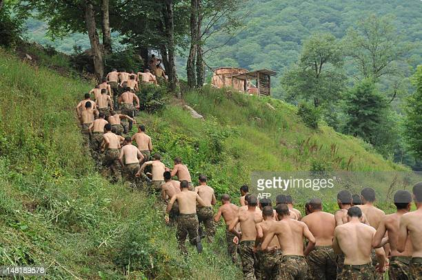 Armenian soldiers of the selfproclaimed republic of NagornoKarabagh run across the country during their training session close to the frontline on...