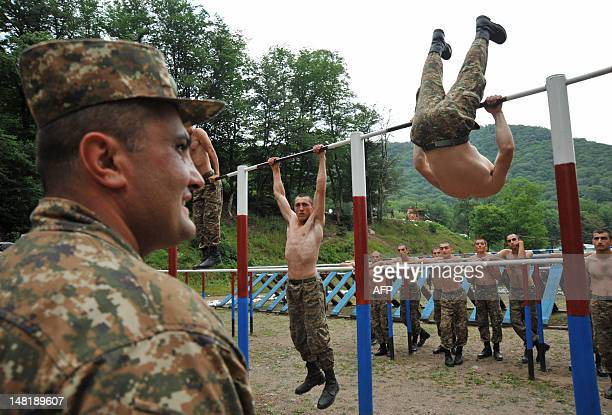 Armenian soldiers of the selfproclaimed republic of NagornoKarabagh workout during their training session close to the frontline on the border with...