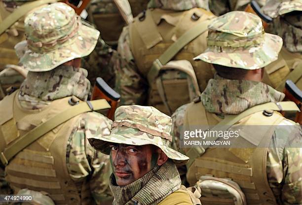Armenian soldiers prepare to take part in a Republic Day parade in central Yerevan on May 28 2015 AFP PHOTO / KAREN MINASYAN
