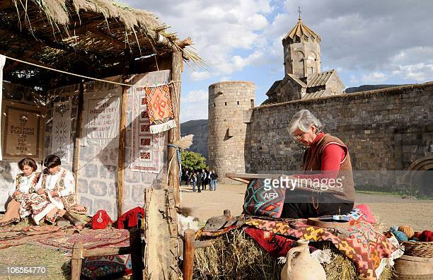 Armenian women prepare their local crafts for tourists visiting ancient Tatev monastery in Armenia's southern mountains close the border with Iran on...