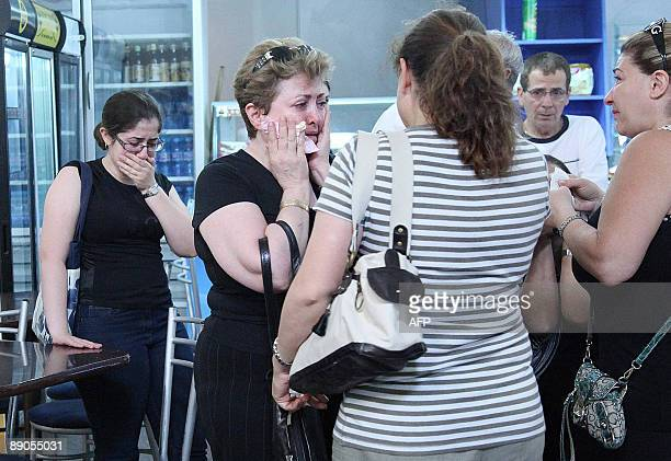 Armenian women relatives of those who died in an Iranian airliner crash cry at the airport in Yerevan on July 16 2009 before boarding a plane to...