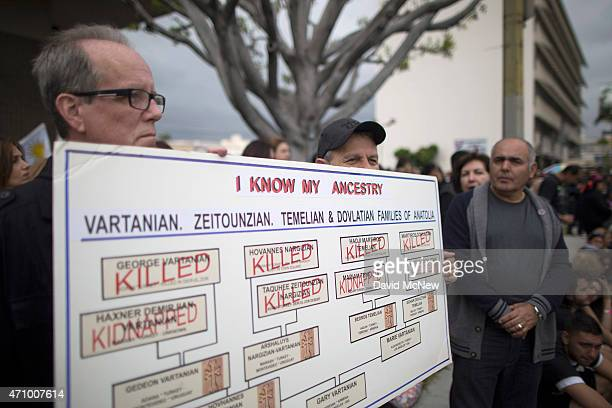 ArmenianAmericans hold a sign tracing their family history to the mass killings of 1915 as they rally in the street near the Turkish Consulate to...