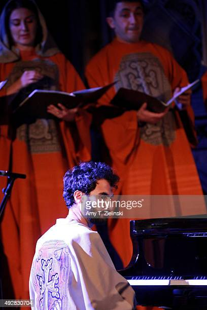 Armenianborn LAbased jazz pianist Tigran Hamasyan performs on a Steinway piano with members of the Yerevan State Chamber Choir tracks from his album...