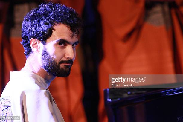 Armenianborn LAbased jazz pianist Tigran Hamasyan performs with members of the Yerevan State Chamber Choir tracks from his album 'Luys i Luso' at the...