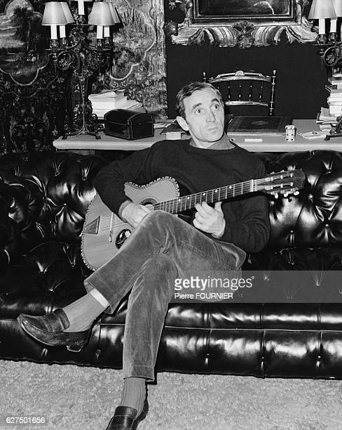 Armenianborn French singer Charles Aznavour at home