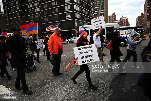 Armenians shout slogans against Turkey as they march to the Turkish Consulate General while marking the 100th anniversary of the mass killings of...