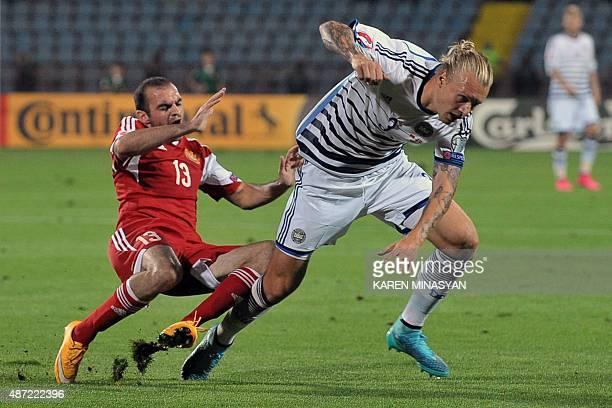 Armenia's defender Kamo Hovhannisyan vies with Denmark's defender Simon Kjær during the Euro 2016 qualifying football match between Armenia and...