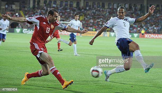 Armenia's defender Kamo Hovhannisyan vies with Portugal's defender Bruno Alves during the UEFA Euro 2016 qualifying round Group I football match...