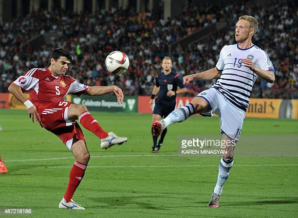 Armenia's defender Robert Arzumanyan vies for the ball with Denmark's forward Nicolai Jorgensen during the Euro 2016 qualifying football match...