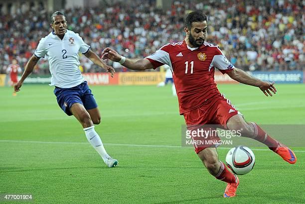 Armenia's forward Artur Sarkisov controls the ball past Portugal's defender Bruno Alves during the UEFA Euro 2016 qualifying round Group I football...