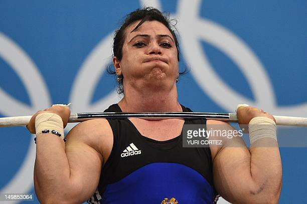 Armenia's Hripsime Khurshudyan competes during the women's 75kg group A weightlifting event of the London 2012 Olympic Games at The Excel Centre in...