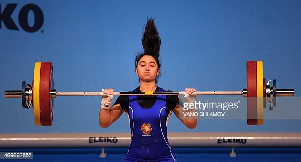 Armenia's Izabella Yaylyan competes in the women's 58A kg category at the European Weightlifting Championships in Tbilisi on April 13 2015 AFP PHOTO...