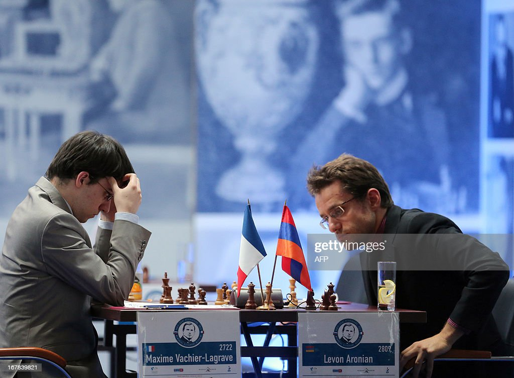 Armenia's Levon Aronian (R) and France's Maxime Vachier-Lagrave play during their final match at the Alekhine Memorial chess tournament in St.Petersburg, on May 1, 2013.
