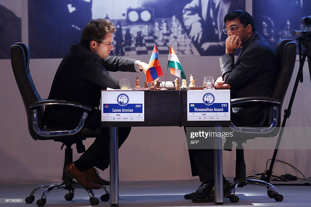Armenia's Levon Aronian (L) plays a move during his round 3 game against India's world champion Viswanathan Anand during the Alekhine Memorial chess tournament on April 23, 2013 in Paris. The tournament is a 10-player single round competition, with the first half held in Paris from April 20 to 25, and the second half in the Russian State Museum in St. Petersburg from April 26 to May 1st.