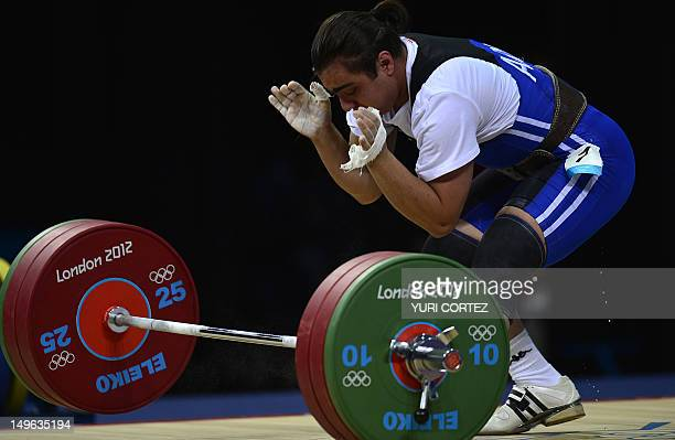 Armenia's Meline Daluzyan fails an attempt during the women's 69kg group A weightlifting event at The Excel Centre in London on August 1 2012 during...