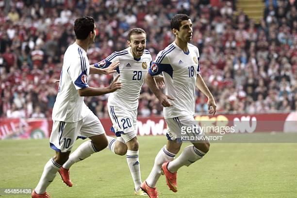 Armenia's midfielder Gevorg Ghazaryan Armenia's defender Levon Hayrapetyan and Armenia's midfielder Henrikh Mkhitaryan celebrate scoring during the...